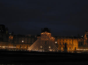 The floodlit pyramid at the Louvre, Paris